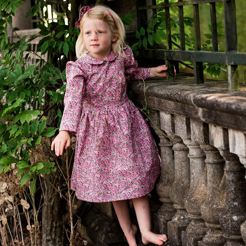 young girl wearing liberty print dress