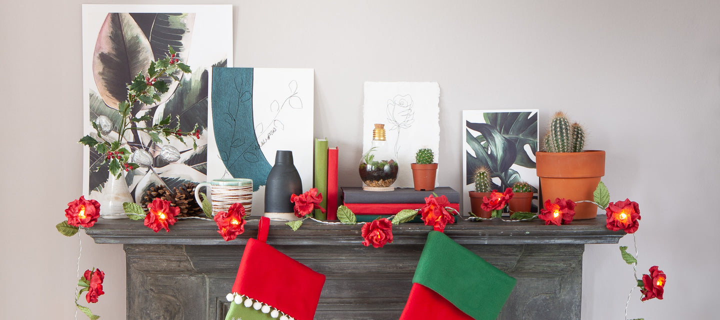 Mantelpiece with prints, stockings, christmas decorations