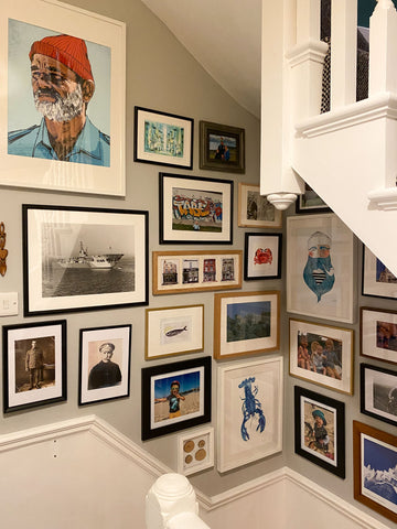 landing hallway with lots of  pictures on wall