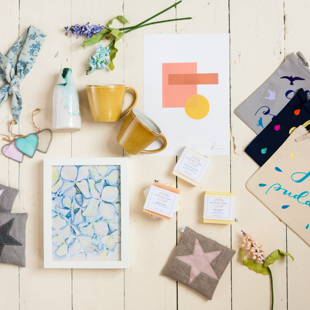 Gifted Local flat lay of hand made mugs, lavender filled bags, prints, Christmas decorations and children's pouches