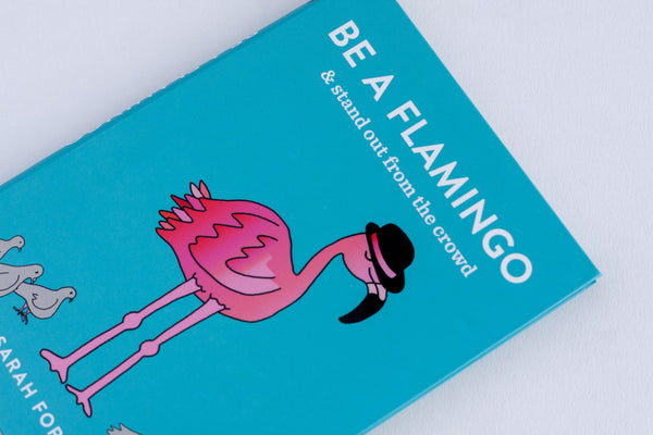 blue illustrated book called be a flamingo and stand out from the crowd