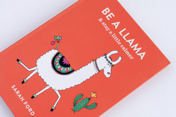 orange illustrated book with a llama called be a llama and stay a little calmer