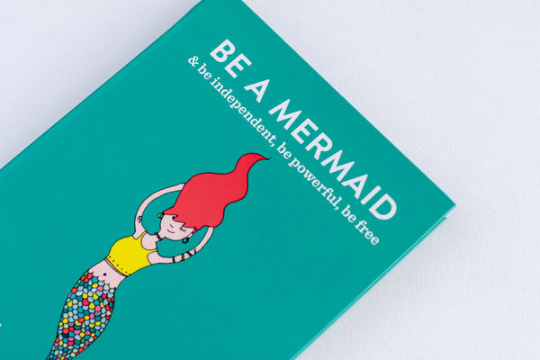 green illustrated book with a mermaid called be a mermaid and be independent powerful and free