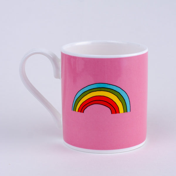 pink mug with a colourful rainbow printed on it