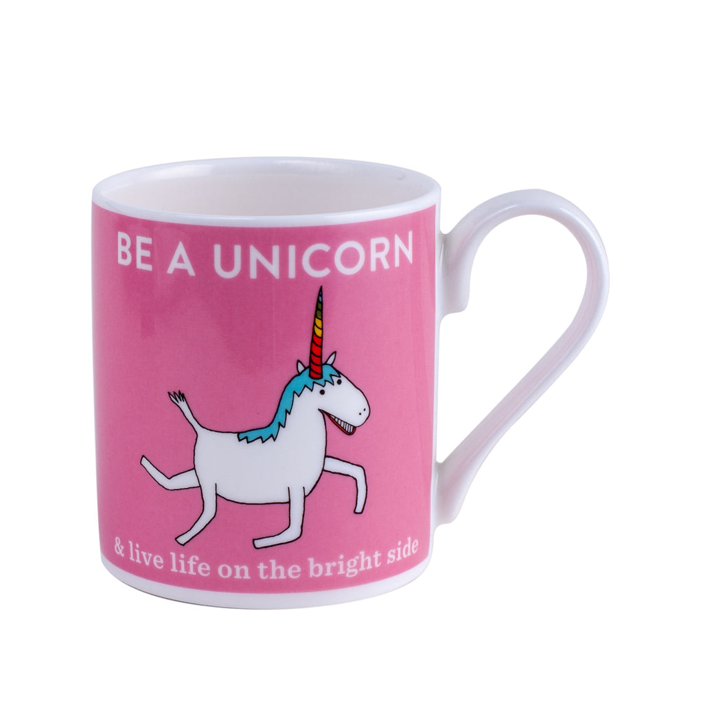 pink mug with a white unicorn and words saying be a unicorn printed on it