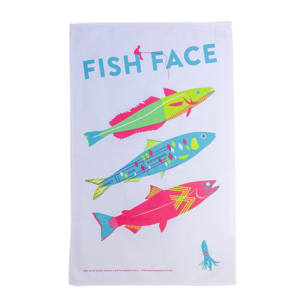 three colourful printed fishes on a teatowel with the word fish face
