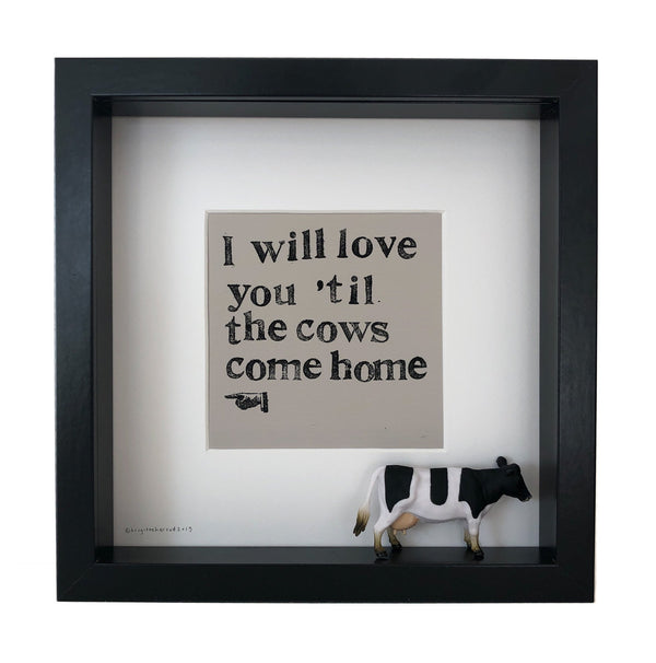 mounted print with the words I will love you til the cows come home with a little figure of a cow encased in the frame