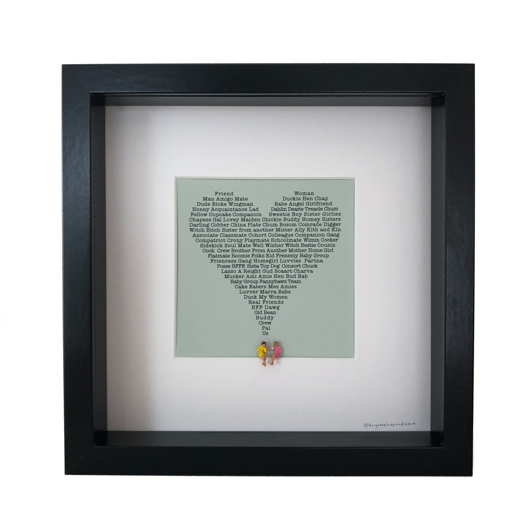 mounted picture of a heart made up of words to describe friendship with two little figures sitting underneath it