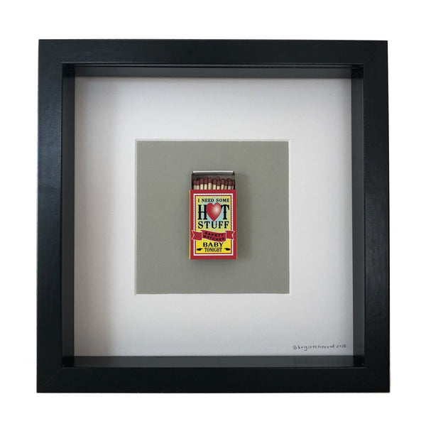 a match box mounted on a piece of card with the words I need some hot stuff baby tonight printed on it