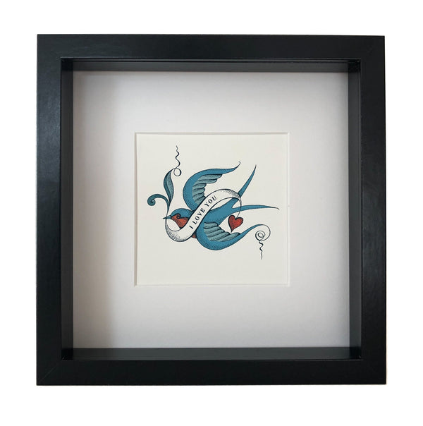 picture of a tattoo like bird with the words I love you enscribed over it mounted and framed