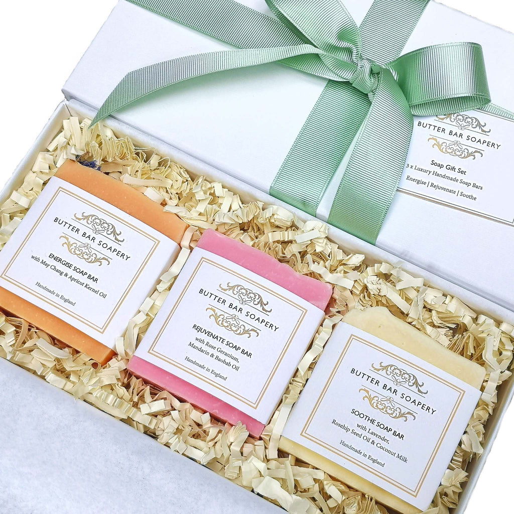 three soaps of different colours nestled in a gift set box