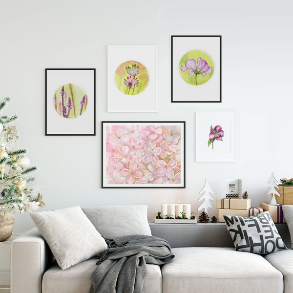 sofa christmas tree and lots of botantical watercolour prints hanging on a white wall