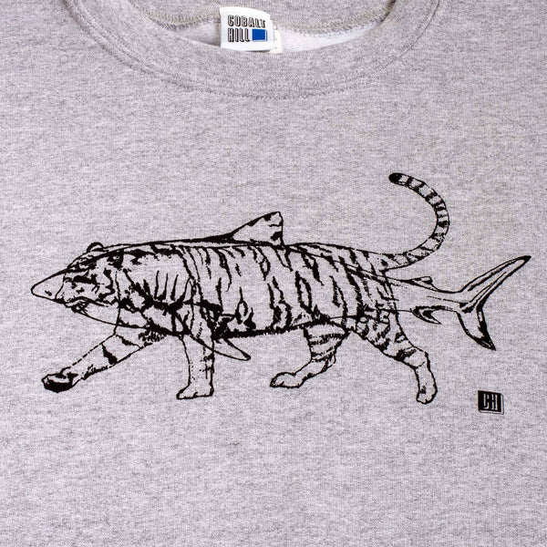 close up of a grey jumper with an outline of a black shark and tiger screenprinted onto it