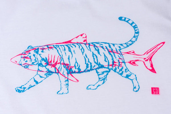 detailed close up of a white tshirt logo which is a fluorescent pink shark and blue tiger superimposed on it