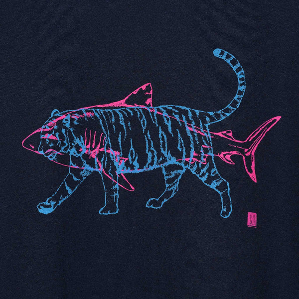 close up of a navy jumper with an outline of a fluorescent pink shark and blue tiger screenprinted onto it