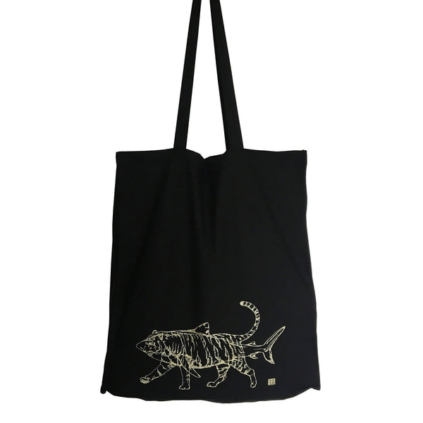 black coloured tote bag with a gold outline of a shark and tiger on it