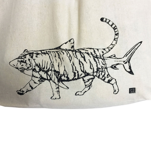 close up detail of a tote bags print which is a black outline of a shark and tiger superimposed on it