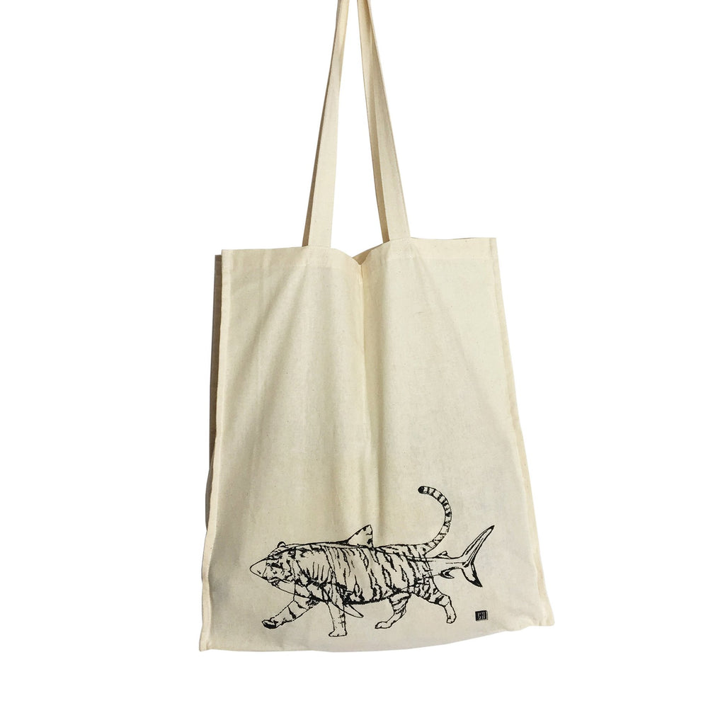 natural coloured tote bag with a black outline of a shark and tiger on it
