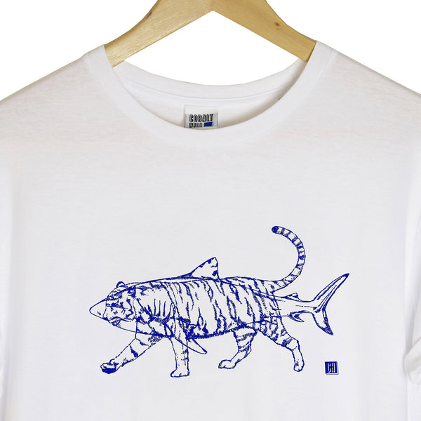 close up detail of a white tshirt with a navy outline of a tiger and shark printed on top of each other hanging on a wooden hanger