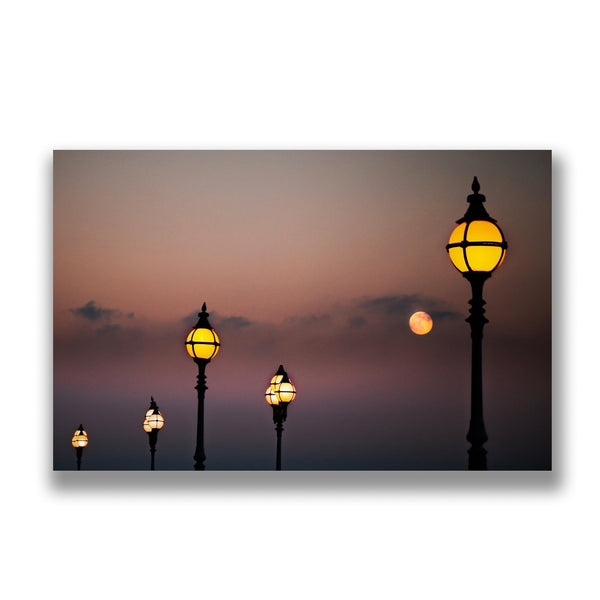a greeting card of the lamp posts around alexandra palace in north london at sunset