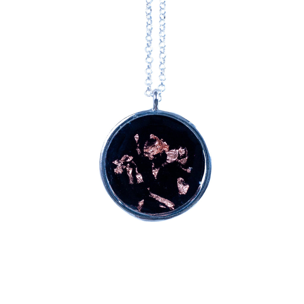 handmade black resin circular pendant with metallic copper foil flakes necklace