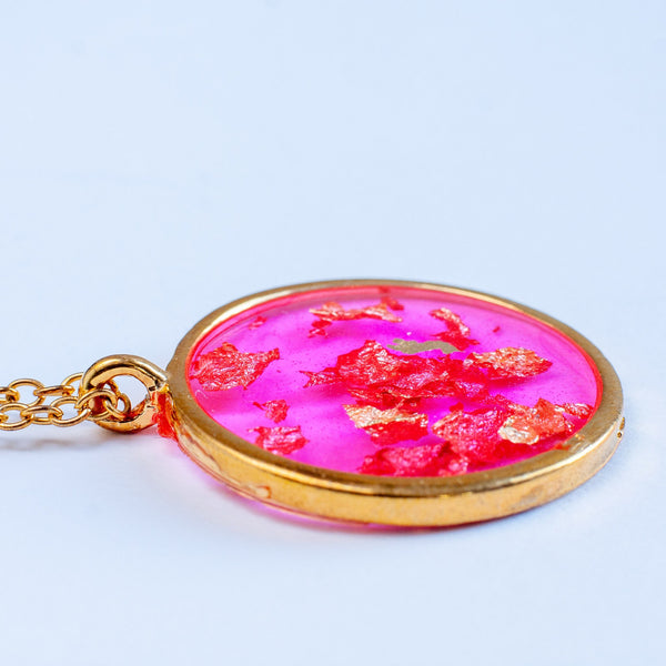 handmade fuschia pink resin circular pendant with metallic gold foil flakes necklace