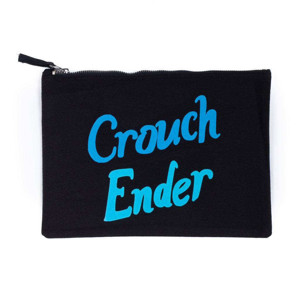 black nappy baby child pouch bag with the words crouch ender printed on it in flourescent light and dark blue
