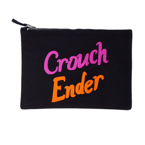 black nappy baby child pouch bag with the words crouch ender printed on it in flourescent pink and orange