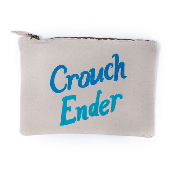 white nappy baby child pouch bag with the words crouch ender printed on it in flourescent light and dark blue