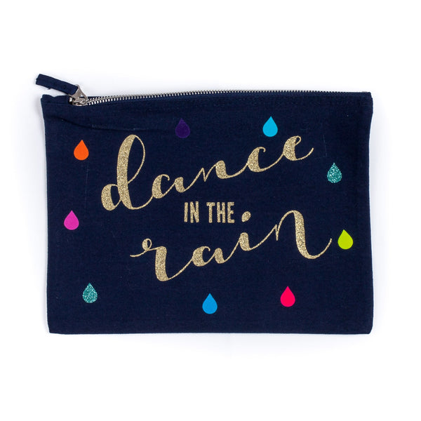 dark coloured baby child nappy pouch bag with the words dance in the rain printed on it in gold with little coloured rain drops decorating the bag