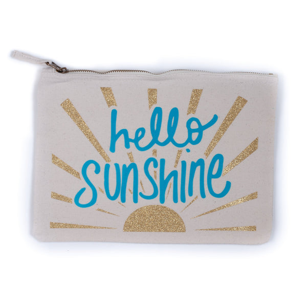 natural coloured baby child nappy pouch bag with the words hello sunshine printed in blue on it and gold sunrays decorating the bag