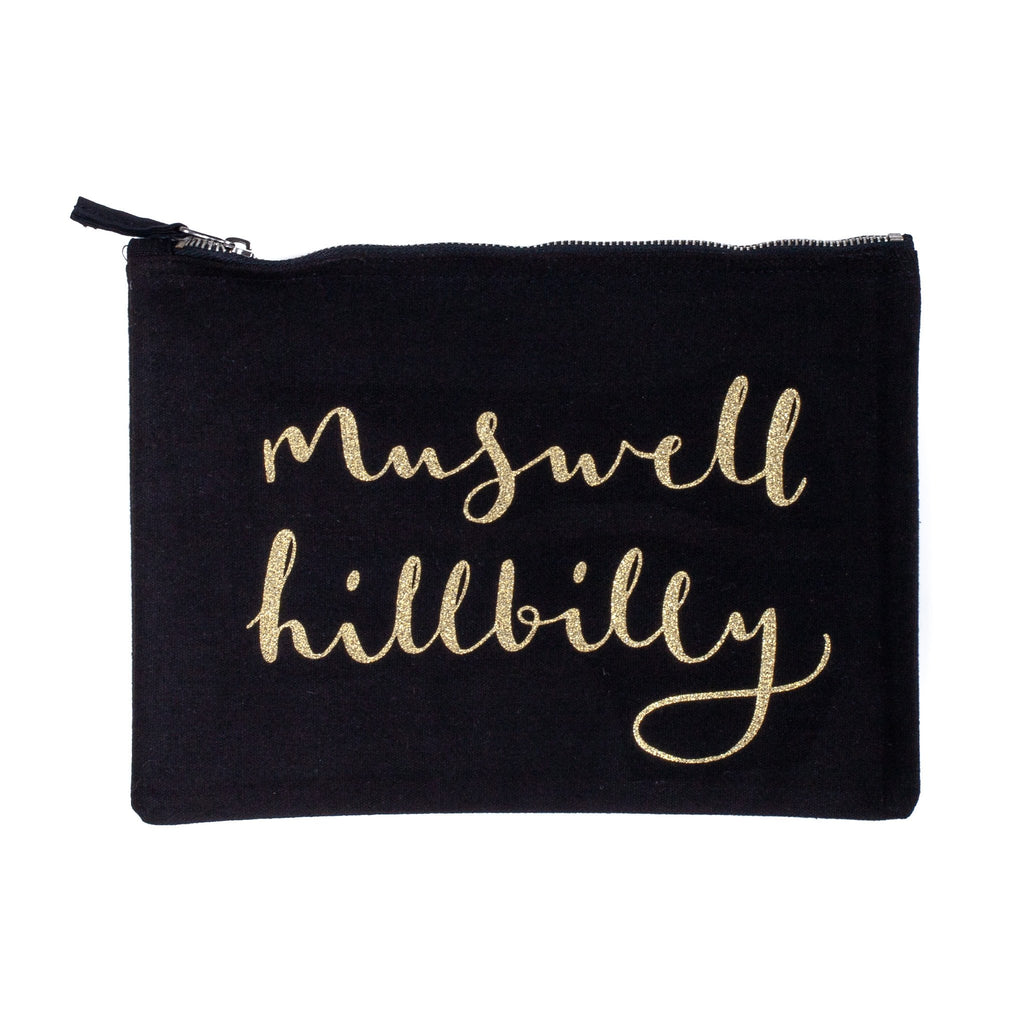 black nappy baby child pouch bag with the words muswell hillbilly printed on it in gold