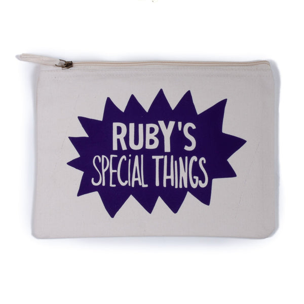 natural coloured baby child nappy pouch bag for baby and children with the words rubys things printed on it in a fun purple splat