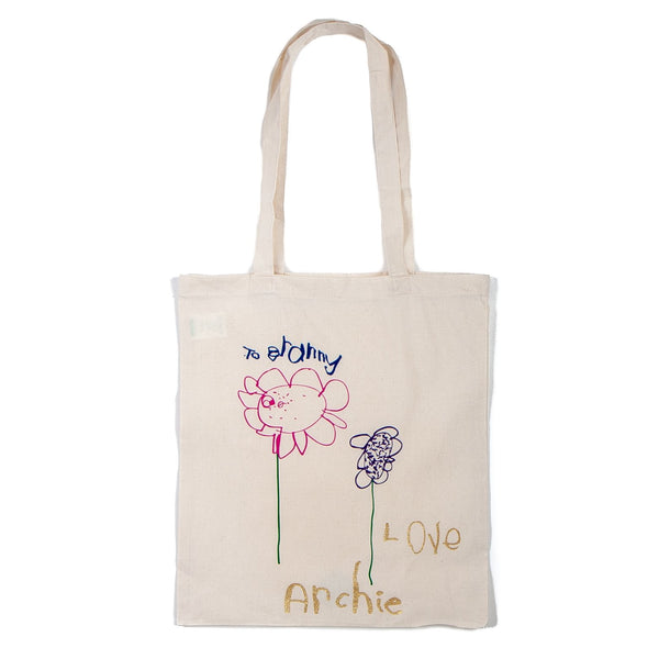 natural coloured tote bag with a personalised childs drawing on it of some flowers