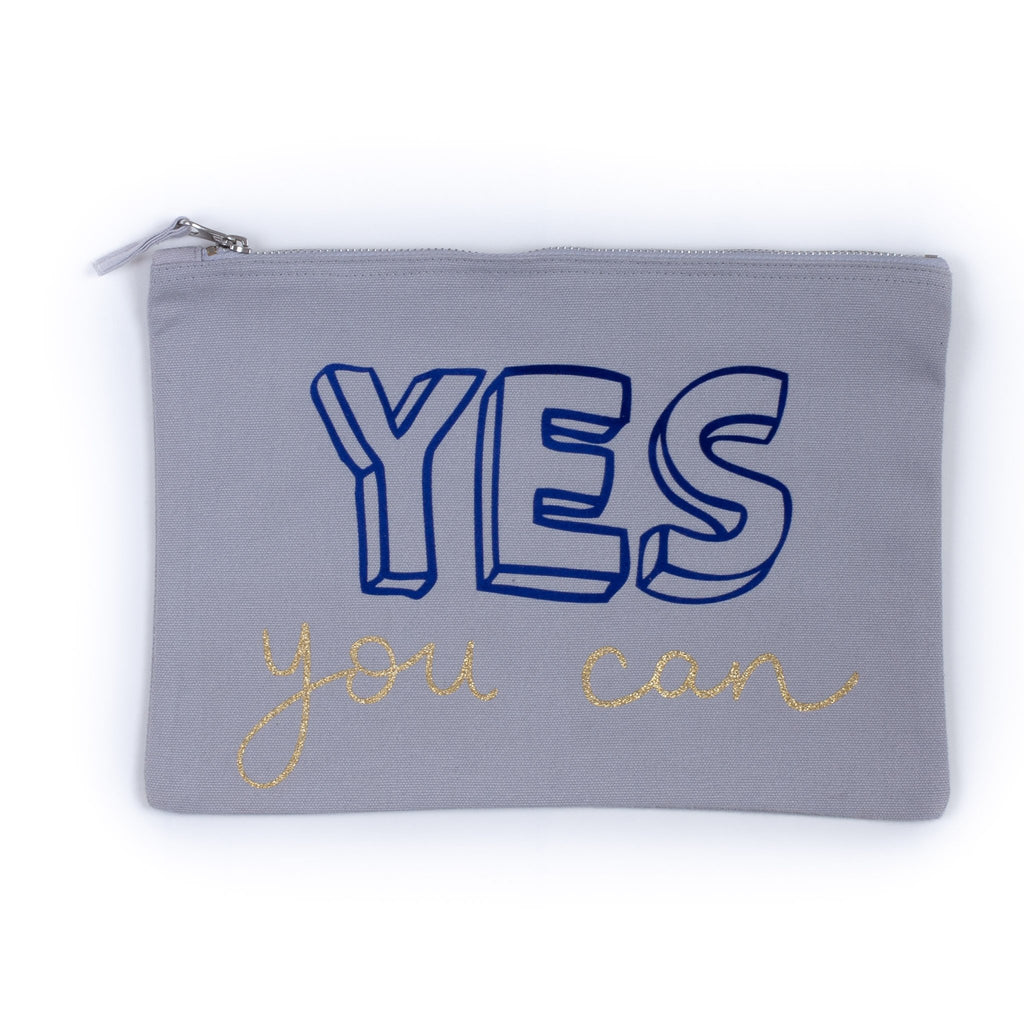blue baby child nappy pouch bag with the words yes you can printed on it in dark blue and gold