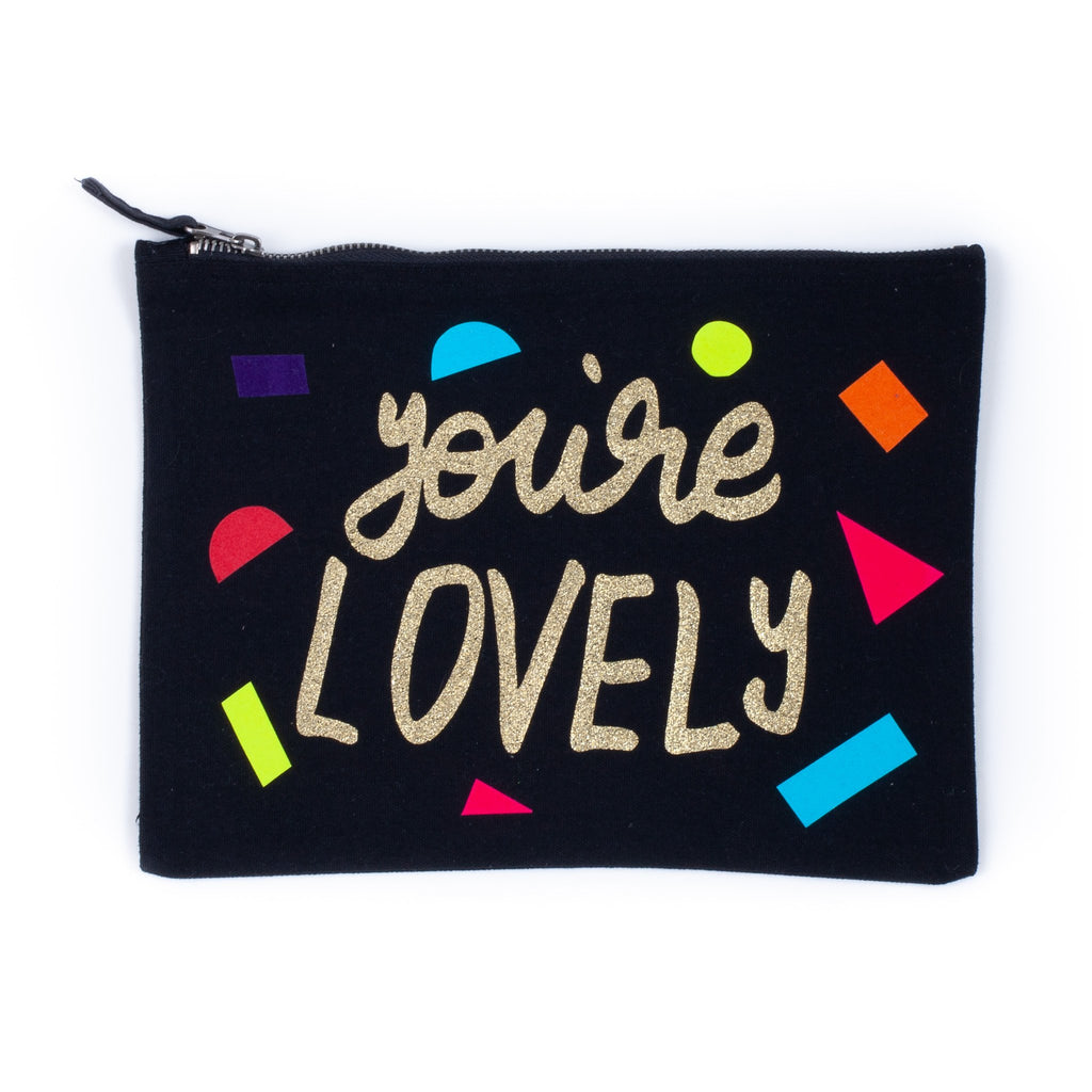 dark coloured baby child nappy pouch bag with the words you are lovely printed on it in gold with little coloured shapes decorating the bag