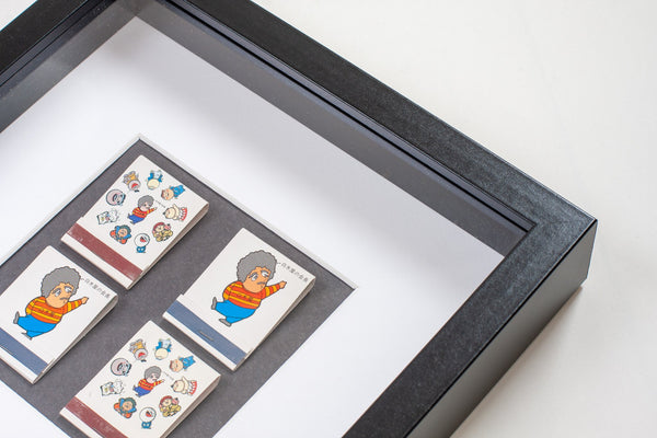 detail of four japanese vintage matchboxes mounted on a grey background all framed