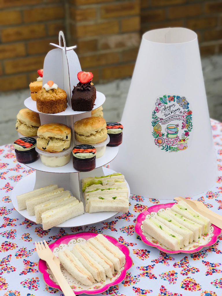 afternoon tea with scones, little sandwiches,  jam and cakes. north london