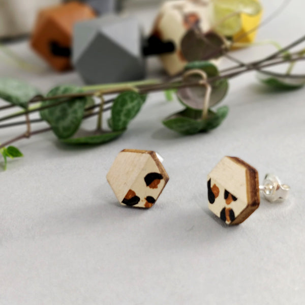 a pair of leopard print stud ladies earrings