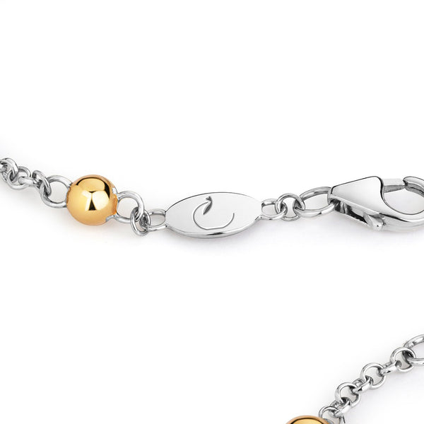 close up of silver chain bracelet with gold dots along its length