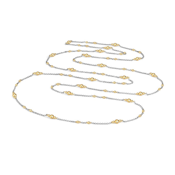 long silver necklace chain with gold dots along the length of it