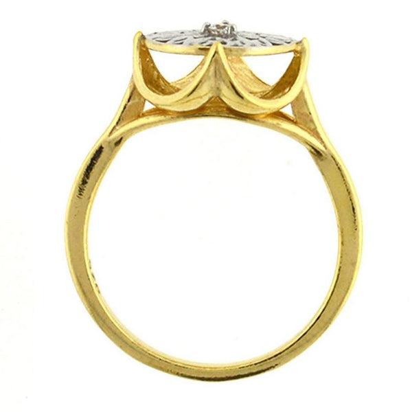 gold ring with a gold and silver crown design in the middle with a cubic zirconia made man stone in the middle