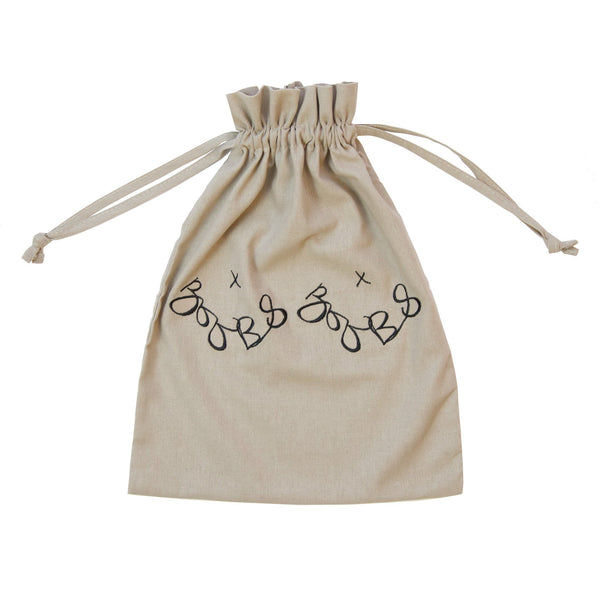 natural colour small draw string bag with a simple graphic on it of boobs