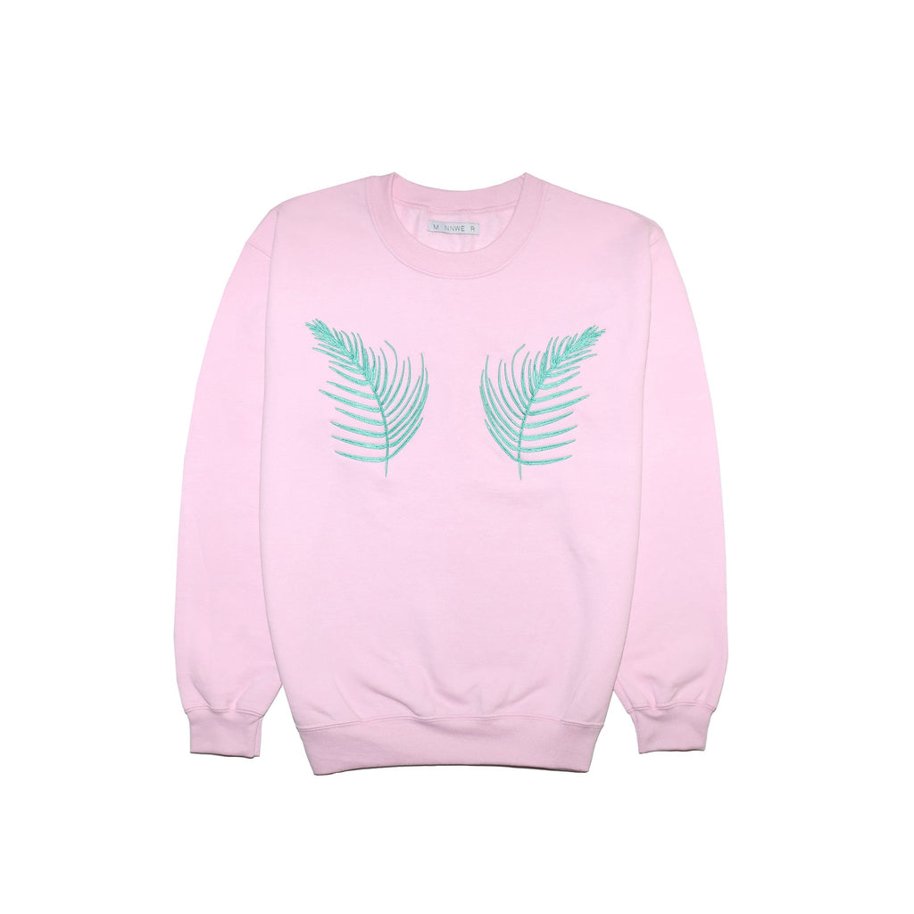 pink jumper sweatshirt with green fern palm leaves embroidered on it