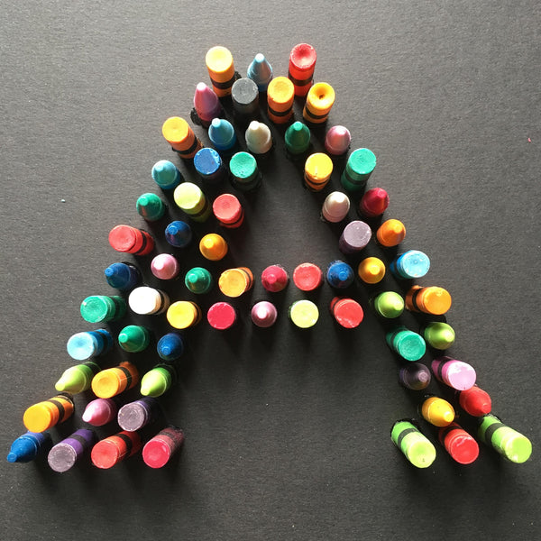 detail of the letter A made of crayons
