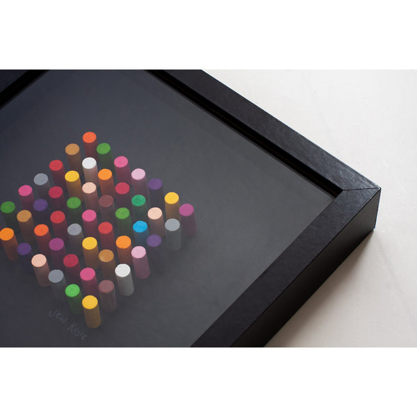 framed picture of crayons arranged in a colourful design