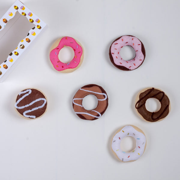 set of toy felt donuts and their box