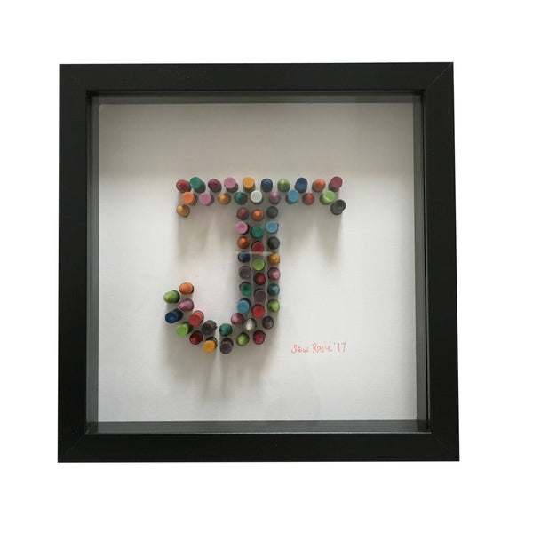 crayon design of the letter J with a black frame