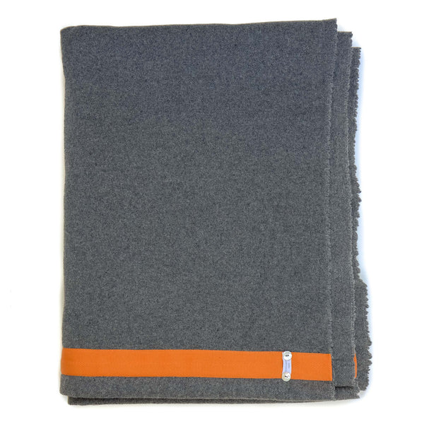 dark grey blanket with orange edge detail