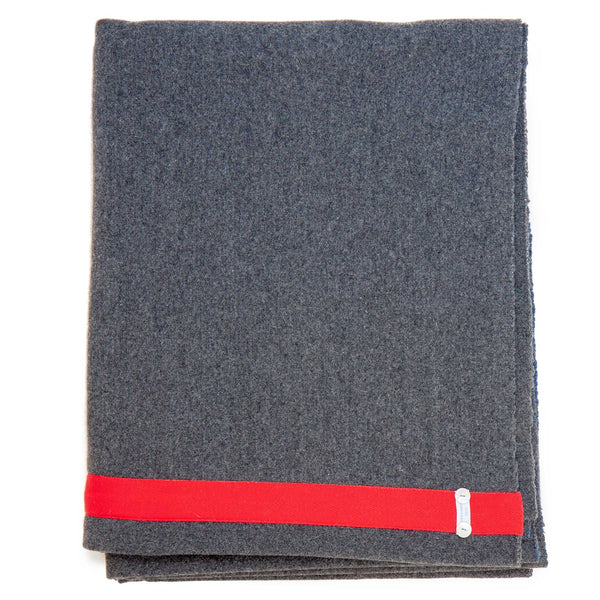 dark grey blanket with red edge detail